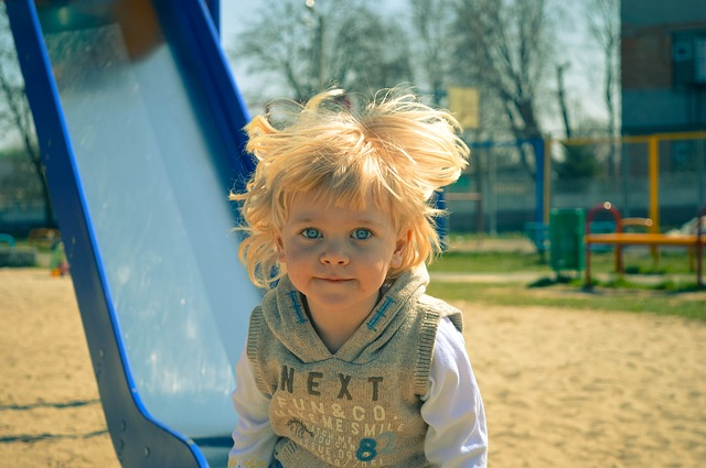 Blond Boy on Slide